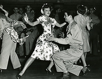1943 Fay McKenzie dancing the Jitterbug with a serviceman at the Hollywood Canteen