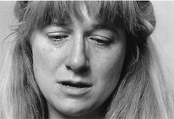 Woman looking depressed on verge of crying,