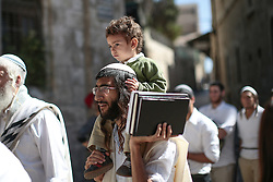 A Jewish settler with a child on his shoulders in East Jerusalem. From a series of photos commissioned by  British NGO, Medical Aid for Palestinians (MAP).