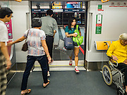 "27 DECEMBER 2015 - SINGAPORE, SINGAPORE:  Passengers get off and on the expanded Downtown Line on the first day of service on the new line. Singapore opened the extension of the Downtown Line on its subway system Sunday. The extension is a part of Singapore's plans to make the city-state a ""car lite"" metropolis with plans to double the current subway to more than 360 kilometers of track by 2030. The government plans to have 80% of homes within a 10 minute walk of a subway station.   PHOTO BY JACK KURTZ"