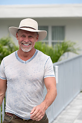 middle aged man enjoying a walk by a motel in Florida