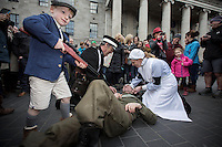 John Gaskin from Louth does a reenactment with members of St John ambulance Susan Bradigan and Des Behan enjoying the Easter Monday 1916 commemorations on O'Connell Street<br />Pic:Mark Condren<br />28.3.2016