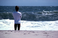 D. Ross Cameron 8/83<br /> <br /> A man watches the heavy surf following a summer storm at Rehoboth Beach, Del.