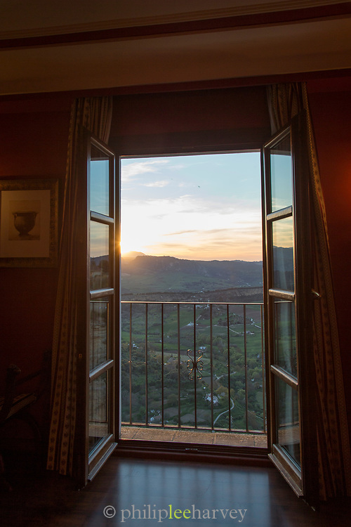Scenic view seen through open door at sunrise, Ronda, Andalusia, Spain