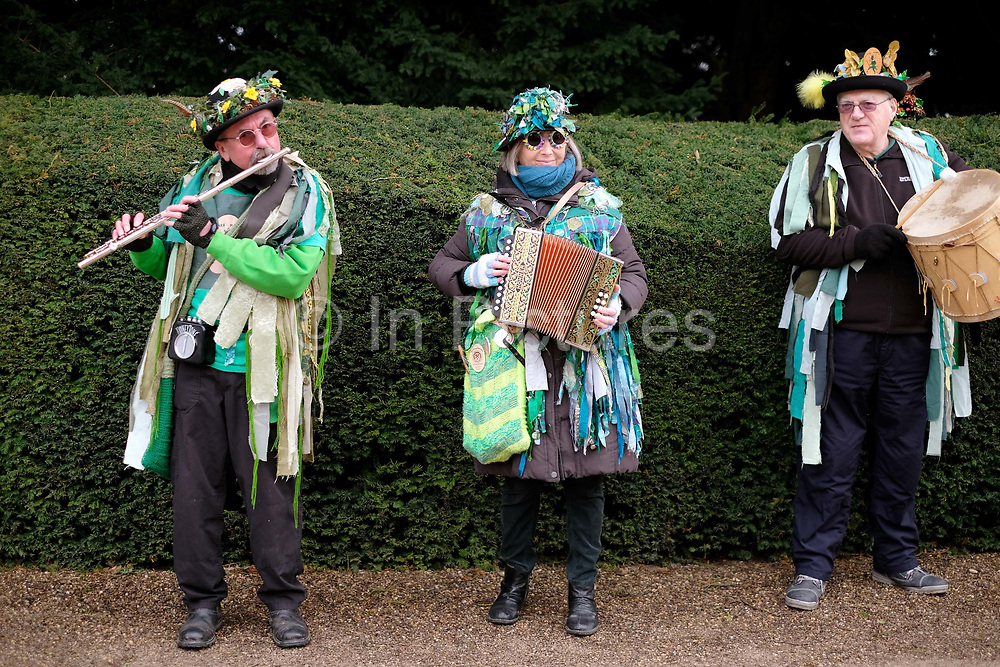 Makara Morris musicians performing at an orchard-visiting wassail at Sledmere House, Yorkshire Wolds, UK on 20th January 2018. Wassail is a traditional Pagan winter celebration in cider-producing regions of England, reciting incantations and singing to the trees to promote a good harvest for the coming year. Pieces of toast soaked in cider are hung in the branches to attract robins to the tree as these are said to be the good spirits of the orchard. To ward off evil spirits, villagers scare them away by banging pots and pans and making as much noise as possible