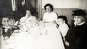 family sitting at the dinner table France ca 1950s