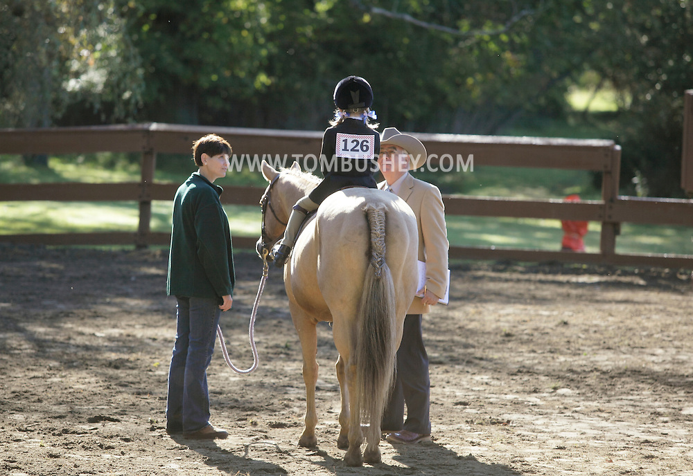 Middletown, NY - A judge, at right, talks to a young rider at the Middletown Rotary Horse Show at Fancher-Davidge Park on Sunday, Sept. 20, 2009.