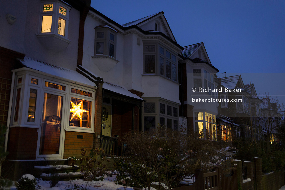 Edwardian period homes in the evening on a winter's afternoon in south London during the bad weather covering every part of the UK and known as the 'Beast from the East' because Siberian winds and very low temperatures have blown across western Europe from Russia, on 1st March 2018, in Lambeth, London, England.