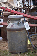 Old milk cans at auction during the Annual Mud Sale to support the Fire Department  in Gordonville, PA.