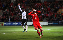 Wales' George Thomas reacts after seeing his goal disallowed for being off-side during the International Friendly match at the Racecourse Ground, Wrexham.