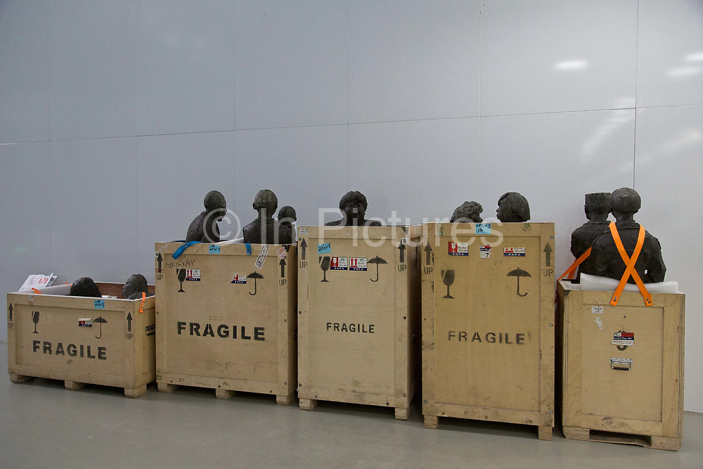 Workers prepare for the next exhibition at the Power Station of Art in Shanghai, China on 15 November, 2013.