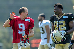 July 28, 2018 - New Orleans, LA, U.S. - METAIRIE, LA. - JULY 28:  New Orleans Saints quarterback Drew Brees (9) talks with tight end Benjamin Watson (82) during New Orleans Saints training camp practice on July 28, 2018 at the Ochsner Sports Performance Center in New Orleans, LA.  (Photo by Stephen Lew/Icon Sportswire) (Credit Image: © Stephen Lew/Icon SMI via ZUMA Press)