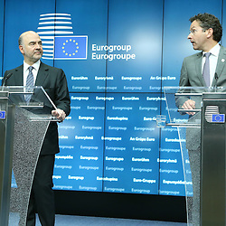 22 June 2015 - Belgium - Brussels - Pierre Moscovici , European Commisioner for Economic and Financial Affairs, Taxation and Customs and Jeroen Dijsselbloem, president of the Eurogroup during his closing press conference about the Greek financial situation.   © Fotogloria / Scorpix / Patrick Mascart
