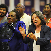 KHAYELITSHA, SOUTH AFRICA - Monday 9 December 2013, the City of Cape Town hosted an Evening of Remembrance at the OR Tambo hall, Khayelitsha. for the late former President of South Africa, Nelson Mandela. MILDRED OLIPHANT, Minister of Labour, and the Executive Mayor of Cape Town, PATRICIA DE LILLE, sing struggle songs.<br /> Photo by Roger Sedres/ImageSA
