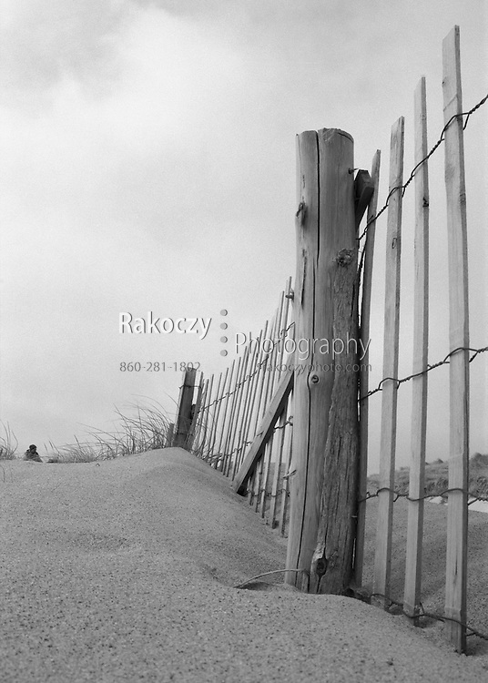 An old fence marks the edge of a dune on the northern tip of Cape Cod, MA.