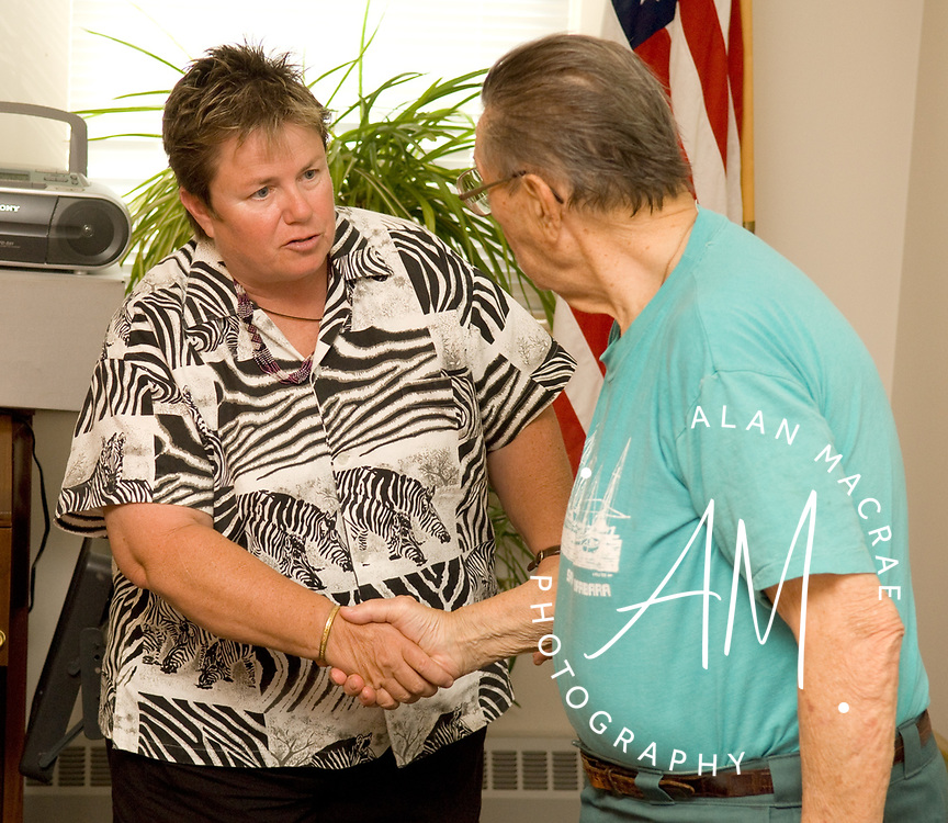 International volunteer Anne Walston visits with retired Rev. Rod Gallant prior to speaking at the Belmont Senior Center on Wednesday, July 25, 2007.  (Alan MacRae/for the Citizen)