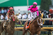 May 4, 2019: 145th Kentucky Derby at Churchill Downs. Maximum Security (right pink) races Country House (left yellow) to the finish. Maximum Security would be disqualified and Country House promoted to win