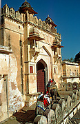 INDIA, JAIPUR Amber Palace and Fort, 16th century; tourists entering through the main gate  by elephant