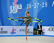 Alina Maksimenko during qualifying at ribbon in the Pesaro World Cup at the Adriatic Arena on 27 April, 2013.<br /> Alina is an Ukrainian individual rhythmic gymnast. She was born on July 10, 1991 in Zaporizhia, Ukraine.