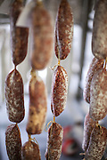 Salami hangs in the aging room in the Red Table Meat Co. production facility at Food Building in Minneapolis, MN.