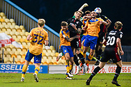 Scunthorpe United George Taft (3) Mansfield Town Farrend Rawson (6) battles for possession during the EFL Sky Bet League 2 match between Mansfield Town and Scunthorpe United at the One Call Stadium, Mansfield, England on 20 April 2021.