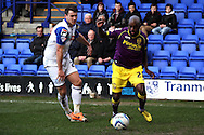 Notts County's Jamal Campbell-Ryce (r) looks to go past Tranmere Rovers' Liam Ridehalgh. Skybet football league one match, Tranmere Rovers v Notts county at Prenton Park in Birkenhead, England on Saturday 15th March 2014.<br /> pic by Chris Stading, Andrew Orchard sports photography.