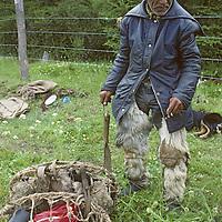 An elderly Chilean huaso (cowboy) relaxes by a road near Cochrane, in Patagonia.