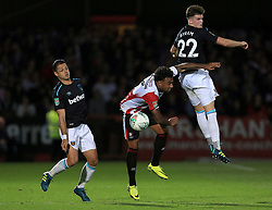 Sam Byram of West Ham United out jumps Jordan Cranston of Cheltenham Town for a header - Mandatory by-line: Paul Roberts/JMP - 23/08/2017 - FOOTBALL - LCI Rail Stadium - Cheltenham, England - Cheltenham Town v West Ham United - Carabao Cup