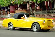 Yellow car in Ciego de Avila, Cuba.