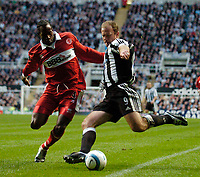 Photo. Andrew Unwin, Digitalsport<br /> Newcastle United v Middlesbrough, Barclays Premiership, St James' Park, Newcastle upon Tyne 27/04/2005.<br /> Newcastle's Alan Shearer (R) fires in a shot past Middlesbrough's Ugo Ehiogu.