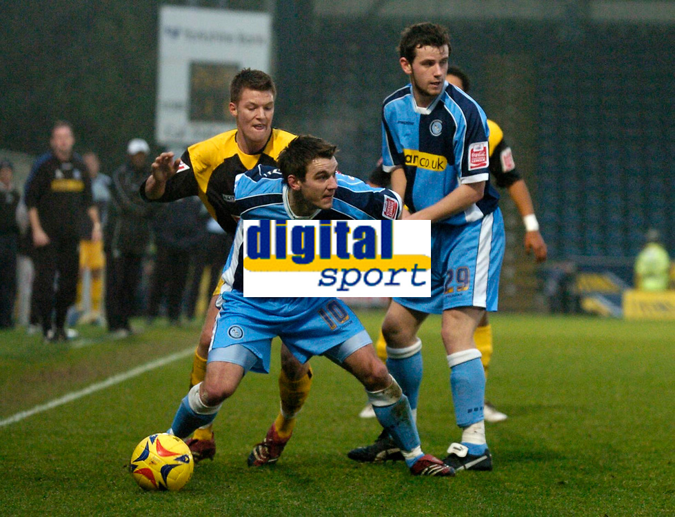 Photo: Richard Lane.<br />Wycombe Wanderers v Stockport County. Coca Cola League 2. 23/12/2006. <br />Wycombe's Matt Bloomfield holds off Stockport's Anthony Pilkington.