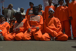 59527274..Yemeni protesters dressed in prison uniforms and in handcuffs attend a rally in front of the U.S embassy in Sanaa, Yemen, on April 16, 2013, demanding the release of prisoners held in Guantanamo prison. Around 90 Yemeni nationals are currently held in the Guantanamo prison, making up the largest part of the remaining detainees at the offshore US facilities, on April 16, 2013, April 17, 2013. Photo by: imago / i-Images. .UK ONLY