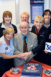 Natwest Bank Gleadless branch 50th Birthday 15th October 2010 .Banks oldest customer 96 year old Douglas Higgins with NatWest Staff from left to rightPam Bartrop, Laura Nicholson, Jill Smith, Alison Hobson and Louise Ironmonger Images © Paul David Drabble
