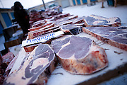Stall with deep-frozen cut meat on the Jakutsk outdoor fish and meat market. Yakutsk is a city in the Russian Far East, located about 4 degrees (450 kilometres) south of the Arctic Circle. It is the capital of the Sakha (Yakutia) Republic in Russia with a major port on the Lena River. The city has a population of 264.000 (2009). Yakutsk is one of the coldest cities on Earth. The average monthly winter temperature in January is around -43,2 C. Yakutsk, Jakutsk, Yakutia, Russian Federation, Russia, RUS, 16.01.2010.