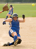 Danielle Dean of the 16U NorEaster Softball team slides safely into third base during Saturday's shutout of the NH Freeze.  Final score 8-0 in five innings.  (Karen Bobotas/for the Laconia Daily Sun)
