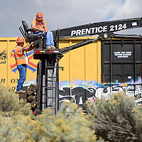 100914       Cable Hoover<br /> <br /> Workers from Richmond, Missouri-based Midwest Contractors use a small crane to collect and stack old railroad ties during a BNSF maintenance project to replace ties near the Fort Wingate Army Depot Friday.