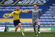 Oxford United Forward Sam Winnall (11) battles for possession  with Burton Albion midfielder (on loan from Blackburn Rovers) Hayden Carter (17) during the EFL Sky Bet League 1 match between Oxford United and Burton Albion at the Kassam Stadium, Oxford, England on 9 May 2021.