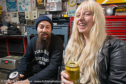 Ryan Grossman with his wife Hanna at the Mooneyes Yokohama Hot Rod & Custom Show after-party at Mooneyes headquarters. Yokohama, Japan. December 7, 2015.  Photography ©2015 Michael Lichter.