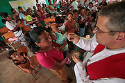 Fr. Craig Pregana an American priest from Fall River, MA conducts mass in the remote village of Majastre, Honduras once a month.  The event brings all of the villagers to mass conducted in the only school house on the mountain.  Honduras is considered the third poorest country in the Western Hemisphere (Haiti, Nicaragua). With over 50% of the population living below the poverty line and 28% unemployed, Hondurans frequently turn to illegal immigration as a solution to their desperate situation. The Department of Homeland Security has noted an 95% increase in illegal immigrants coming from Honduras between 2000 and 2009, the largest increase of any country.