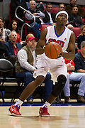 DALLAS, TX - NOVEMBER 25: Ben Emelogu #21 of the SMU Mustangs brings the ball up court against the Arkansas Razorbacks on November 25, 2014 at Moody Coliseum in Dallas, Texas.  (Photo by Cooper Neill/Getty Images) *** Local Caption *** Ben Emelogu