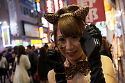 A young Japanese woman dressed as a sexy pussycat enjoys the Halloween celebrations in Shibuya. Saturday October 28th 2017