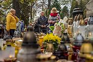 People arrive at Rakowicki cemetery in Krakow, Poland 2019.