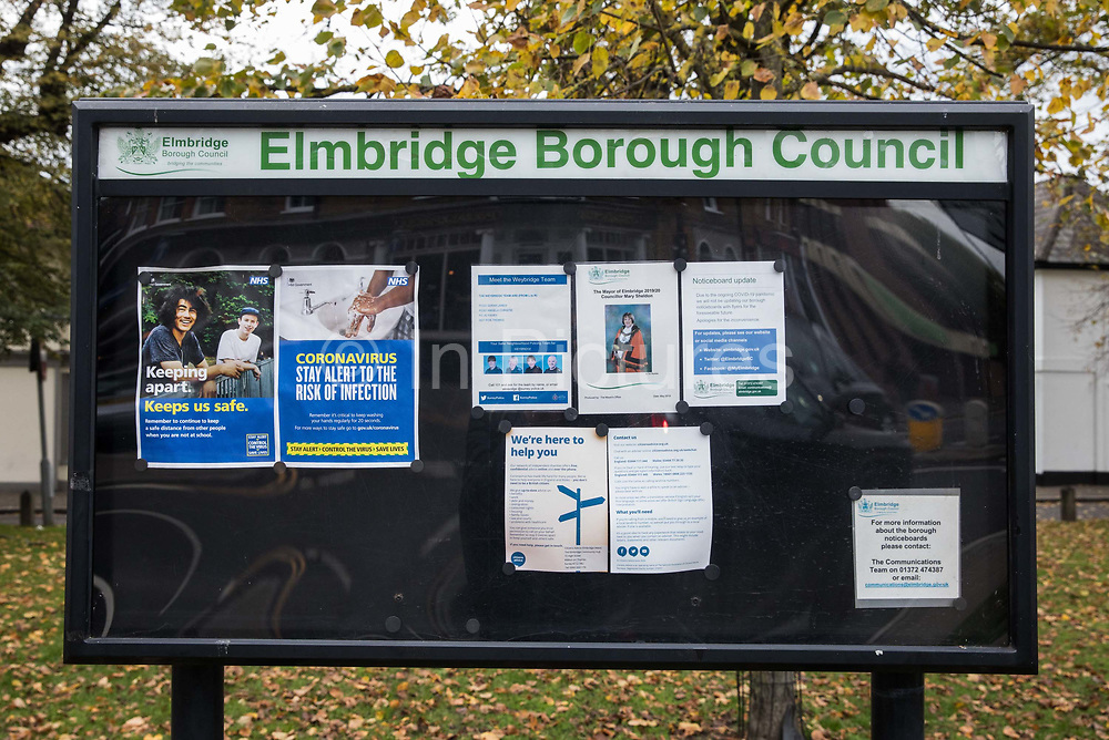 An Elmbridge Borough Council notice board containing instructions relating to the coronavirus is pictured on 16 October 2020 in Weybridge, United Kingdom. The Government has announced that the Borough of Elmbridge, which contains the towns of Weybridge, Esher, Cobham, Walton-on-Thames and Molesey, will move into Tier 2 of the Government's new three-tier Local COVID Alert Level system for England with effect from 00.01 on Saturday 17th October, designating it an area of 'High' risk following a significant rise in the number of COVID-19 cases.