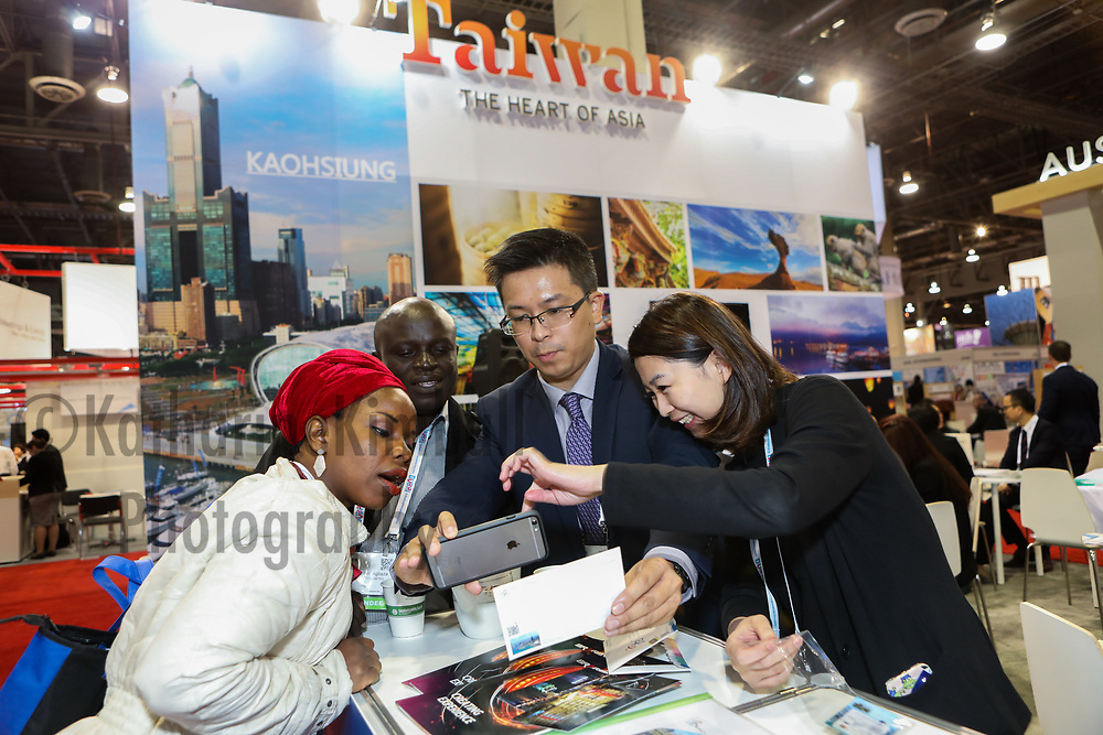 Attendees visit the Taiwan booth at the IMEX America Expo.