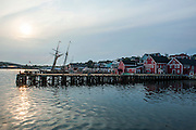 Sun reflecting in the water in the harbour of the old Town Lunenburg, Unesco world heritage sight, Nova Scotia, Canada, USA