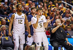 Dec 1, 2019; Morgantown, WV, USA; West Virginia Mountaineers guard Jordan McCabe (5) and West Virginia Mountaineers guard Taz Sherman (12) celebrate from the bench during the second half against the Rhode Island Rams at WVU Coliseum. Mandatory Credit: Ben Queen-USA TODAY Sports
