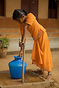 Girl in Orange.  Photograph taken at Bethel near Danishpet, India.