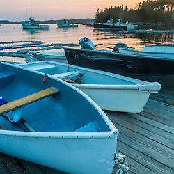 Skiffs at sunset at the Spuce Head Fisherman's Co-op in South Thomaston, Maine.