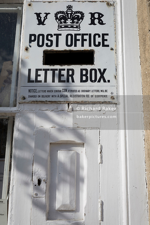 The Victorian letter posting box outside the local shop and post office in the Northumbrian village of Blanchland, on 29th September 2017, in Blanchland, Northumberland, England. Blanchland is a village in Northumberland, England, on the County Durham boundary. The population of the Civil Parish at the 2011 census was 135. Blanchland was formed out of the medieval Blanchland Abbey property by Nathaniel Crew, 3rd Baron Crew, the Bishop of Durham, 1674-1722. It is a conservation village, largely built of stone from the remains of the 12th-century Abbey. It features picturesque houses, set against a backdrop of deep woods and open moors. Set beside the river in a wooded section of the Derwent valley, Blanchland is an attractive small village in the North Pennines Area of Outstanding Natural Beauty.