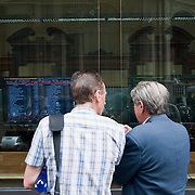 MILAN, ITALY - JUNE 28:  Two passers by discuss the Italian financial crisis in front of monitors displaying the stock market on June 7, 2010 in Milan, Italy. Today the Italian stock market suffered new losses in particular the banking sector and the Euro falls below $1.19, the lowest in over 4 years <br /> <br /> ***Agreed Fee's Apply To All Image Use***<br /> Marco Secchi /Xianpix<br />  tel +44 (0) 207 1939846<br />  e-mail ms@msecchi.com <br /> www.marcosecchi.com